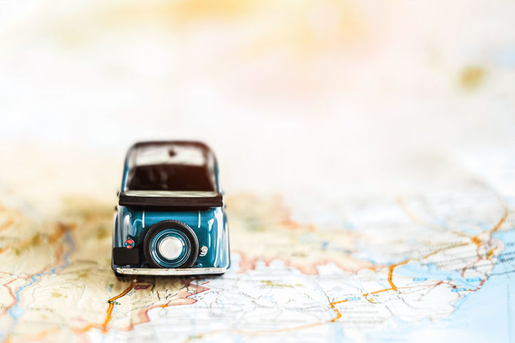 Map Travel Copy Space Technology Photography Themes Direction Camera - Photographic Equipment Selective Focus Close-up Focus On Foreground Journey Guidance No People Indoors  Studio Shot Holiday Adventure Trip Exploration Vacations