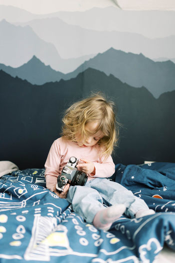 Portrait of boy on bed