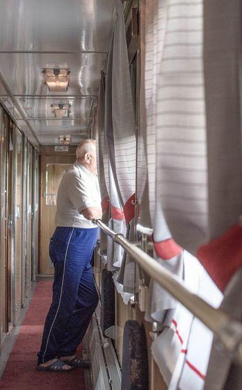 Woman standing in corridor