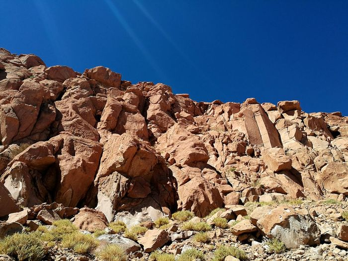 Rocks being hard can shape things as much as soft clouds Rock - Object Nature Outdoors Sunlight Beauty In Nature Day Desert Sky Cliff Clear Sky Brown