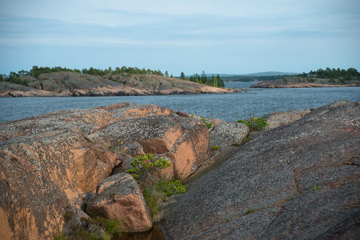 Beauty In Nature Blue Calm Forest Granite Gulf Of Bothnia Horizon Over Water Idyllic Islands Nature No People Non Urban Scene Outdoors Rock Formation Rock Islands Scenics Sea Sky Tranquility Water
