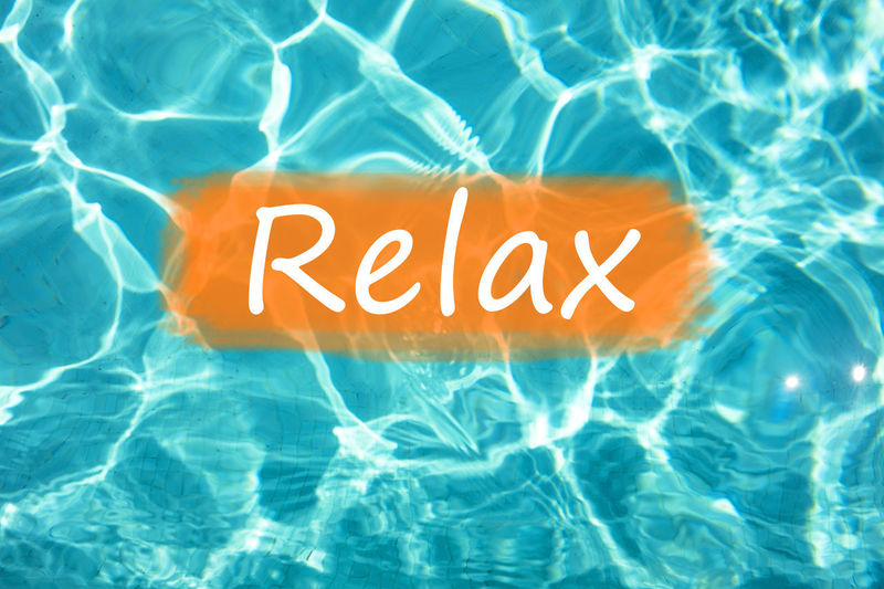 """Detail of word """"Relax"""" on swimming pool water and sun reflecting on the surface. Freshness Fun Holiday Holidays Postcard Reflection Relaxing Summertime Swimming Text Background Backgrounds Enjoyment Fresh Leisure Activity Relax Relaxation Relaxing Time Summer Swimming Pool Wallpaper Water"""
