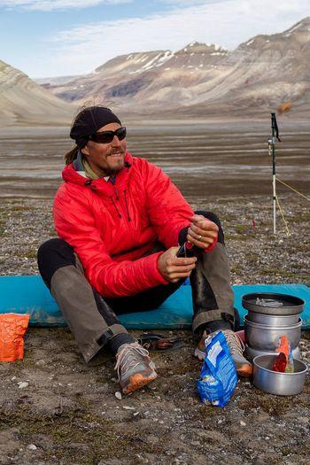 Mature Man Sitting In Mountains