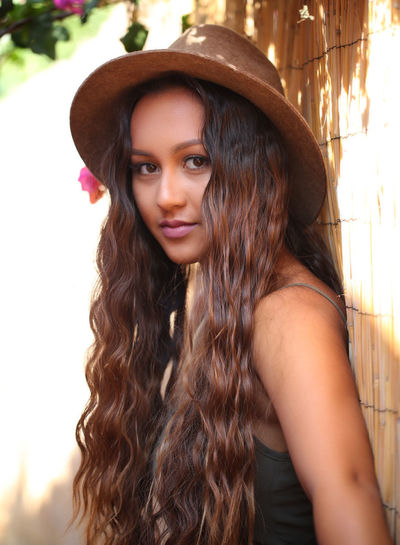 Pretty girl with long brown hair and a suntan Beauty In Nature Brown Brown Eyes Cute Female Long Hair Person Pretty Sunset Suntanned Water Woman Young Adult Young Women