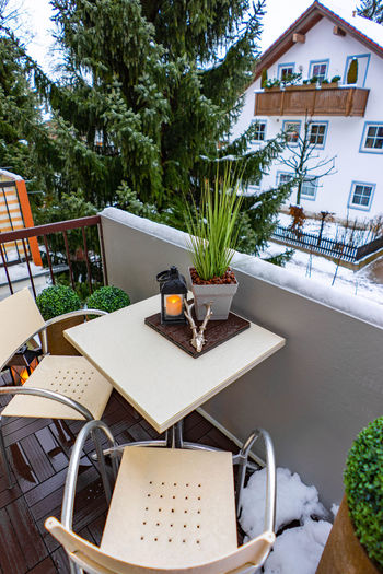 Balcony in the winter time Table Architecture Building Exterior Chair Building Built Structure Front Or Back Yard Seat Plant Tree No People Food And Drink Nature Absence Day Residential District Food House Potted Plant Furniture Outdoors Flower Pot
