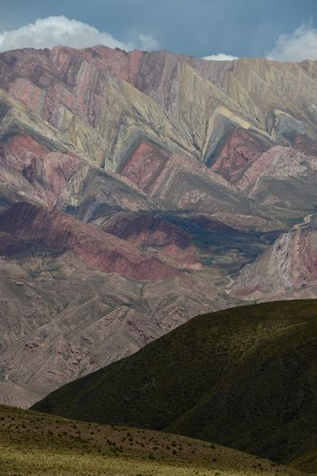 Cerro de 14 colores (Hornocal), Jujuy, Argentine Green Color Red Rocky Arid Climate Beauty In Nature Colorful Day High Altitude Landscape Mountain Mountain Range Nature No People Outdoors Physical Geography Purple Scenics Sky Tranquil Scene Tranquility Travel Destinations Violet White Yellow