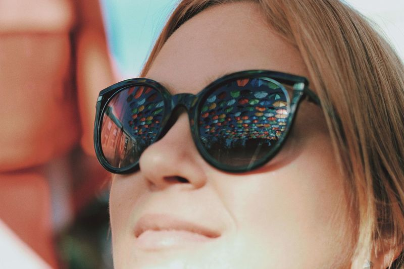 Umbrella Glasses One Person Sunglasses Fashion Headshot Close-up Portrait Real People Human Body Part Lifestyles Body Part Young Women Leisure Activity Adult Young Adult Reflection Human Face Day Front View Beautiful Woman A New Beginning