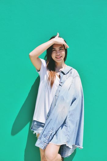 One Person Young Adult Clothing Hat Green Color Young Women Portrait Fashion Smiling Green Background Front View