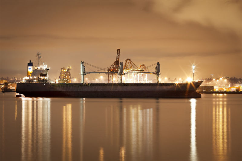 View of illuminated commercial dock against sky