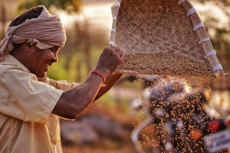 The Portraitist - 2017 EyeEm Awards Men Adult Working Adults Only Only Men Outdoors People Agriculture One Person Farmer One Man Only Manual Worker Occupation Real People Day Nature Close-up Portrait Hardwork Determination Happy Happy Farmer EyeEmNewHere Winnowing