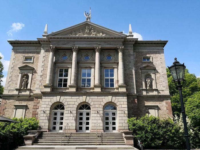Deutsches Theater Göttingen theater Deutsches Theater Deutsches Theater Göttingen City Politics And Government Clock Face Clear Sky History Architecture Sky Close-up Building Exterior Monument Statue Sculpted Human Representation Pedestal Idol Historic Façade Sculpture