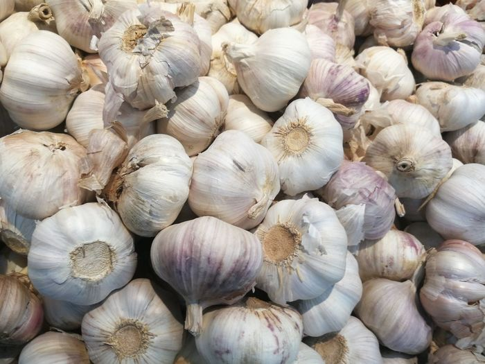 Full frame shot of garlic for sale in market stall