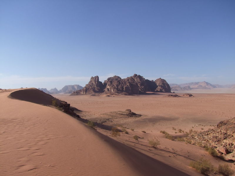 Wadi Rum Landscape Amazing View Arid Climate Beauty In Nature Blue Sky White Clouds Composition Desert Desolate Scene Famous Place Geology Jordan Landscape National Park Nature No People Outdoor Photography Sand Sand Dune Sandstone Rock Formation Scenics Sunlight And Shadow Tourist Attraction  Tourist Destination Tranquility Scene Unusual Beauty Wadi Rum