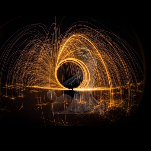 Paint The Town Yellow Long Exposure Circle Night Outdoors Abstract Light Effect Motion Fireball Flame Statue Man Woman Spark Sparks Sparkle Sparkling SparksFly Fly Flying Circle Circling Light Shadow Fire