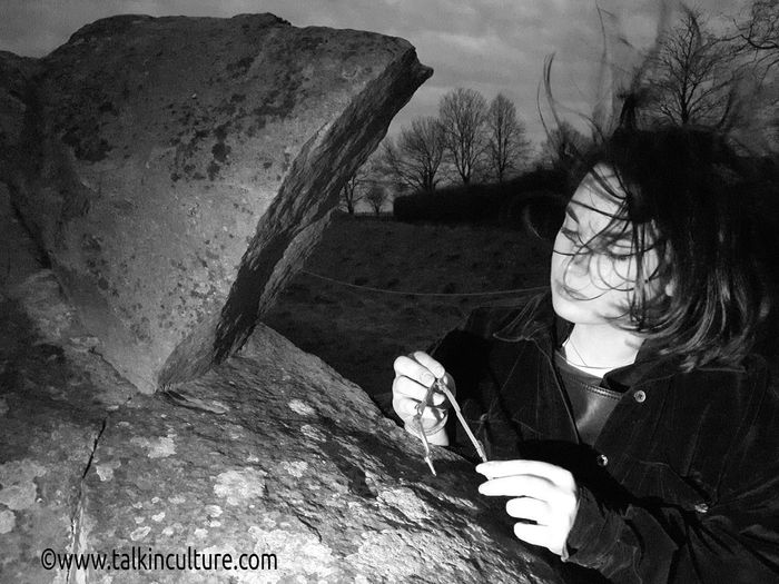 Young conservation pioneer in cultural heritage. Portrait Culture Heritage Conservation Mystical Stone Standingstones Wiltshire UK Avebury Stones Skateboard Park Astronomy Sky Close-up