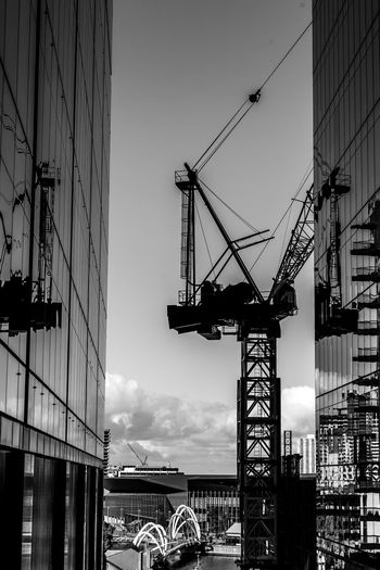 Cranes with its reflection off office windows Architecture Business City Construction Industry Office Reflection Reinforcements Scaffolding Silhouette Apartment Beam Blue Boom Building Built Commercial Crane Development Engineer Engineering Glass Population Sky Structure