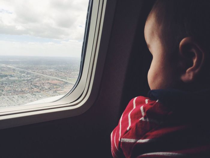 The Photojournalist - 2017 EyeEm Awards Finn's first airplane ride Window Mode Of Transport Looking Through Window Airplane Journey Travel First Airplane Flight visual ambassadors
