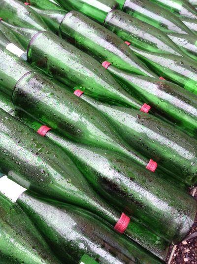 Full Frame Shot Of Green Bottles