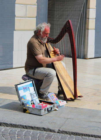 One Man Only Musical Instrument One Person Music Senior Adult Adult Adults Only People Arts Culture And Entertainment Day Outdoors Lifestyles Musician Skill  Only Men Sitting Harp Art Music Streetmusician Street