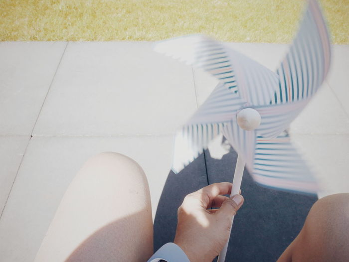 Outdoors Propeller Low Section Summer Women Relaxation Human Hand Beach High Angle View Shadow Patio Human Foot Human Leg Garden Party Personal Perspective Visual Creativity Analogue Sound