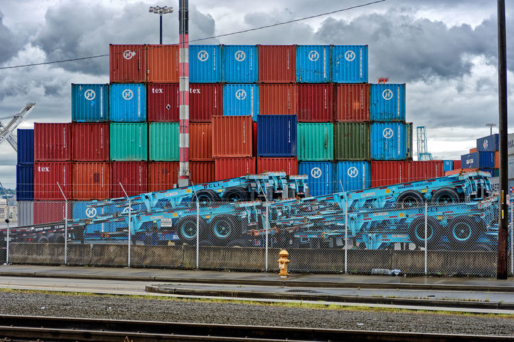 Port Of Seattle Shipping Containers Cargo Container Cloud - Sky Commercial Dock Container Day Freight Transportation Harbor Industry Mode Of Transport Multi Colored Nautical Vessel No People Outdoors Port Railroad Track Shipping  Shipping  Shipping Docks Shipping Terminal Shippingport Shipyard Sky Transportation