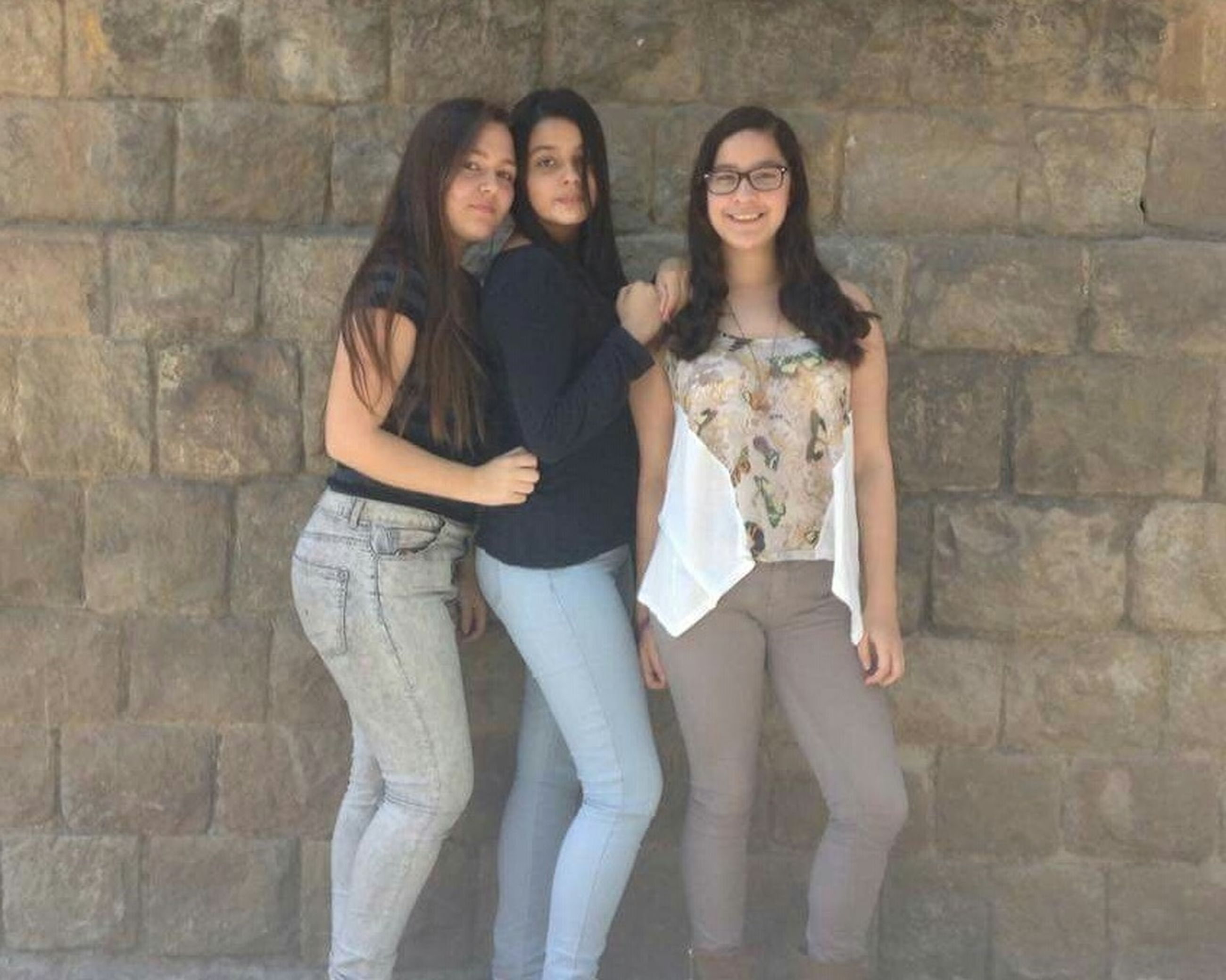 young adult, lifestyles, person, young women, casual clothing, leisure activity, front view, standing, looking at camera, wall - building feature, portrait, three quarter length, togetherness, smiling, bonding, full length