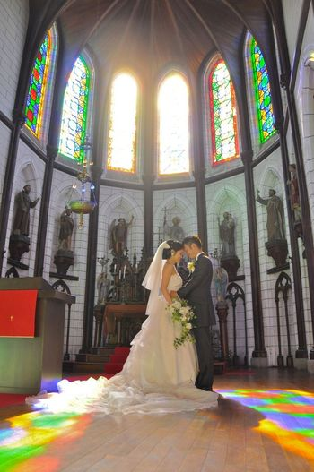 Altar Architecture Art And Craft Belief Building Built Structure Celebration Glass Human Representation Indoors  Place Of Worship Positive Emotion Religion Spirituality Stained Glass Sunlight Wedding Window Women