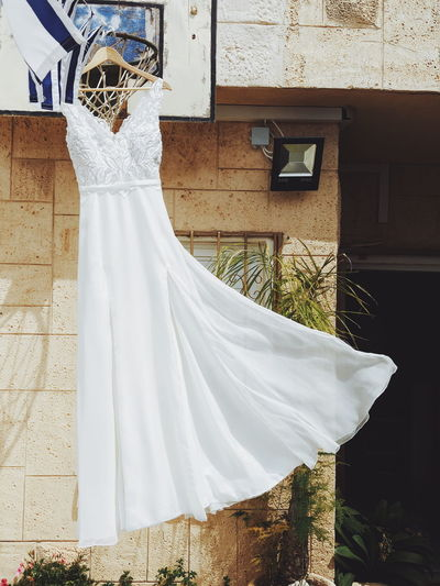 Architecture Belief Building Building Exterior Built Structure Celebration Clothing Day Dress Event Hanging House Life Events No People Religion Textile Wedding Wedding Dress White Color