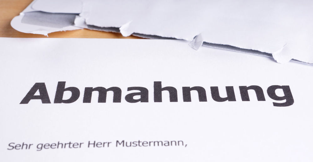 Abmahnung = German cease-and-desist letter Abgemahnt Abmahnung Abmahnwelle Brief Business Cease-and-desist Envelope Law Legal Letter Office Open Warning