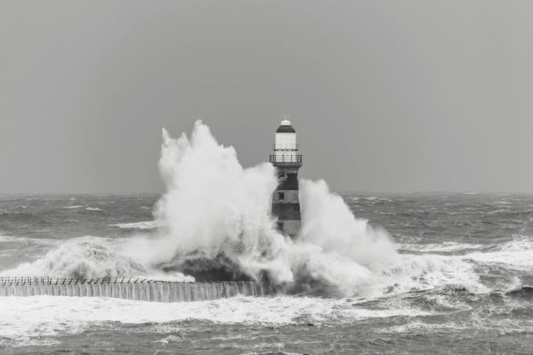 EyeEm Best Shots EyeEm Best Shots EyeEm Sea Lighthouse Wave Safety Water Horizon Over Water Guidance Architecture Protection Motion Built Structure Direction Force Power In Nature Building Exterior Rough Day Outdoors Nature Breaking