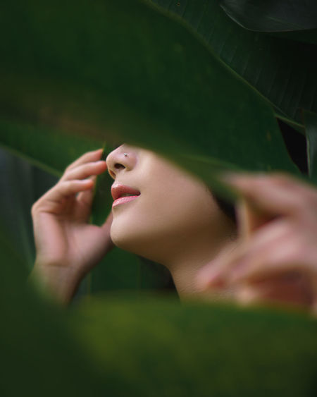 Close-up of woman hand on grass
