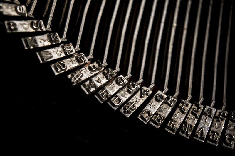 Cropped image of typewriter on black background
