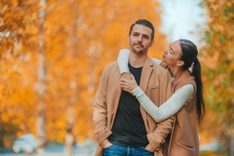 Young couple standing during autumn