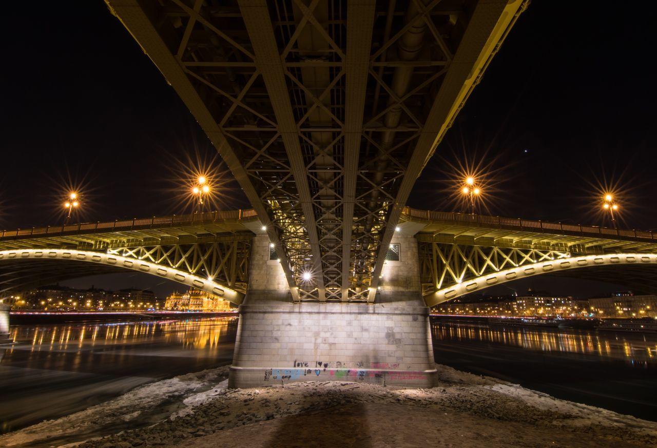 bridge - man made structure, illuminated, connection, engineering, night, transportation, architecture, built structure, below, suspension bridge, bridge, no people, underneath, chain bridge, outdoors, sky