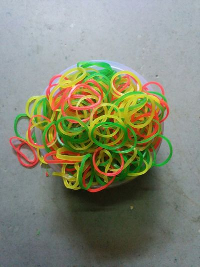 Multi Colored Tangled Rubber Band Flexibility Variation Complexity Connection Intertwined No People Multicolours Rubber