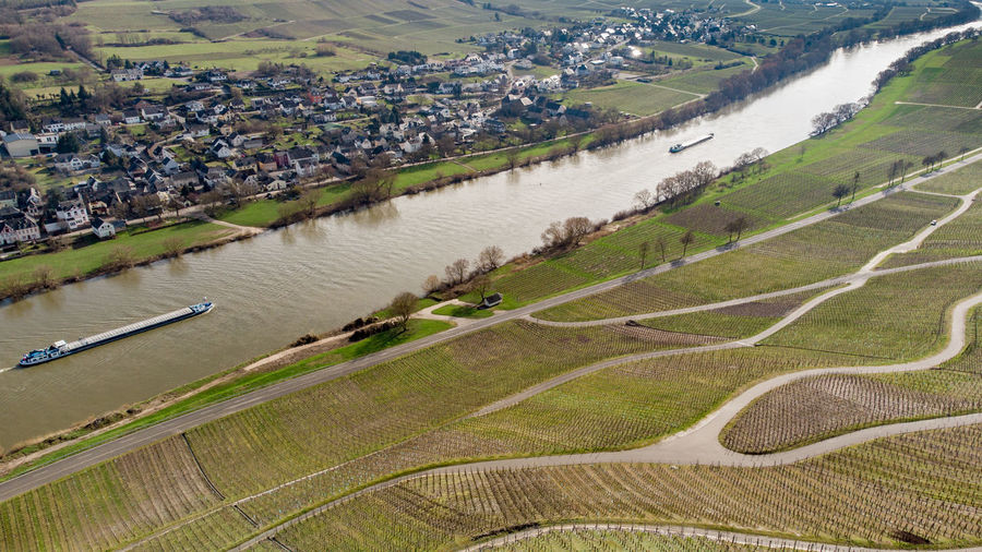 Aerial view of the river moselle valley with cargo ship and the village brauneberg