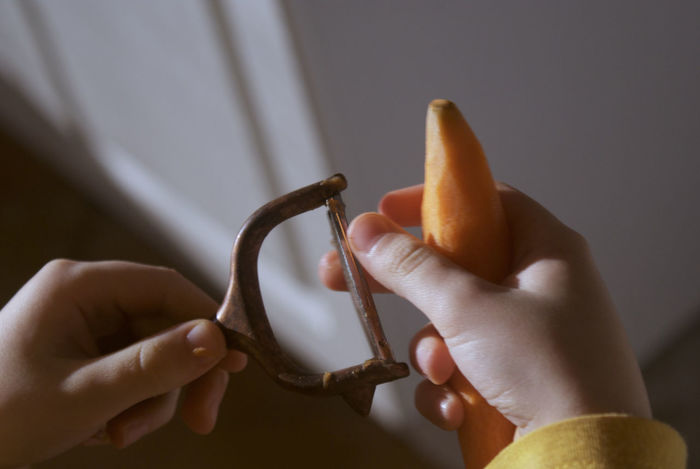 First work with the vegetable cutter. Carrot Childhood Close-up Cutter Helping Hand Holding Housework Human Body Part Human Hand Indoors  Real People Sharp Vegetable Vegetables & Fruits Work Tool Family EyeEm Gallery Eye4photography  EyeEmNewHere Capture The Moment Cooking Lieblin Gsteil Food And Drink Freshness Thumb