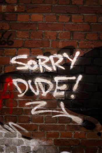 Text written on brick wall