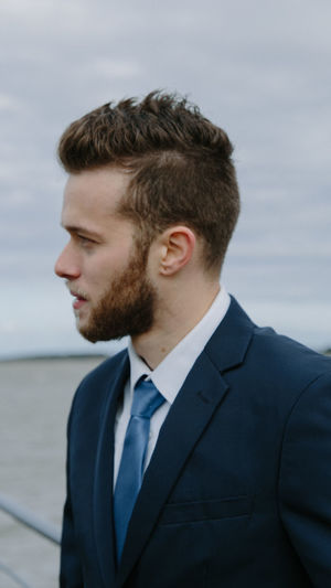 Adult Beard Business Business Person Contemplation Day Focus On Foreground Headshot Looking Men Menswear One Person Portrait Real People Standing Suit Water Well-dressed Young Adult Young Men