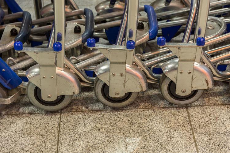 Close-up of shopping cart wheels