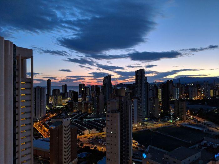 Illuminated Buildings Against Sky At Dusk