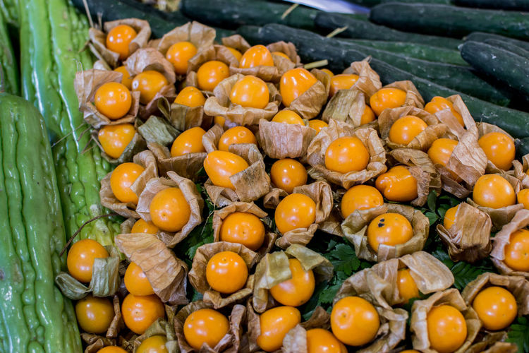 Abundance Close-up Day Focus On Foreground Food Food And Drink Freshness Fruit Gooseberry Fruit Healthy Eating High Angle View Large Group Of Objects Leaf Market Nature No People Outdoors Persimmon Ripe Still Life Vegetable Wellbeing