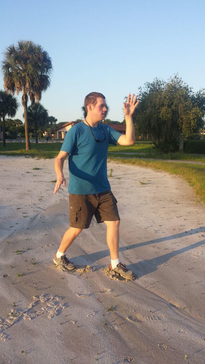 Man Dancing On Beach