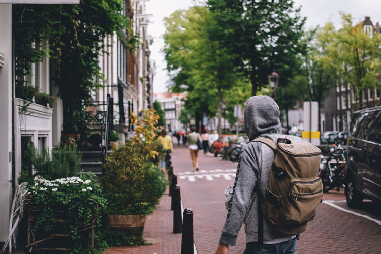 One Person Plant Real People City Rear View Lifestyles Street Architecture Tree Men Day Building Exterior City Life Leisure Activity Built Structure Nature Incidental People Standing Focus On Foreground Outdoors Warm Clothing EyeEm Best Shots EyeEm Gallery EyeEm Selects EyeEmNewHere