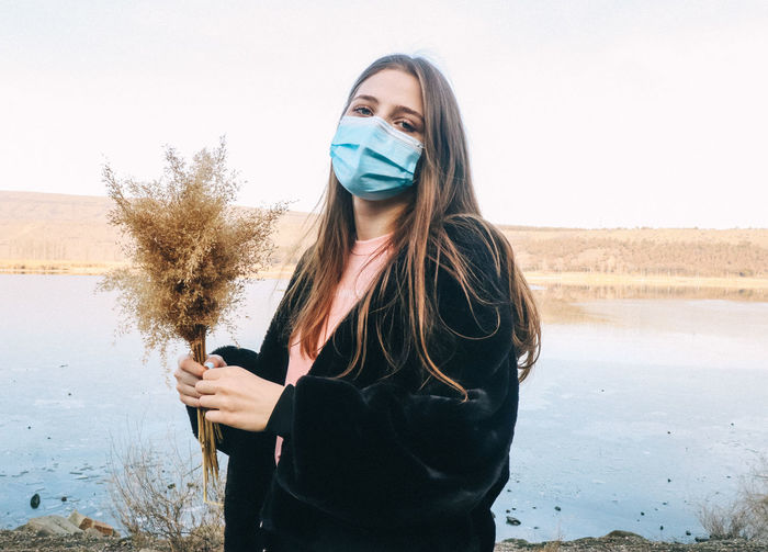Portrait of young woman while pandemic