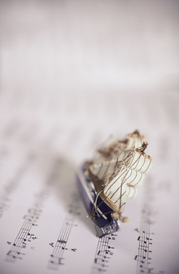 Close-up of toy boat on paper