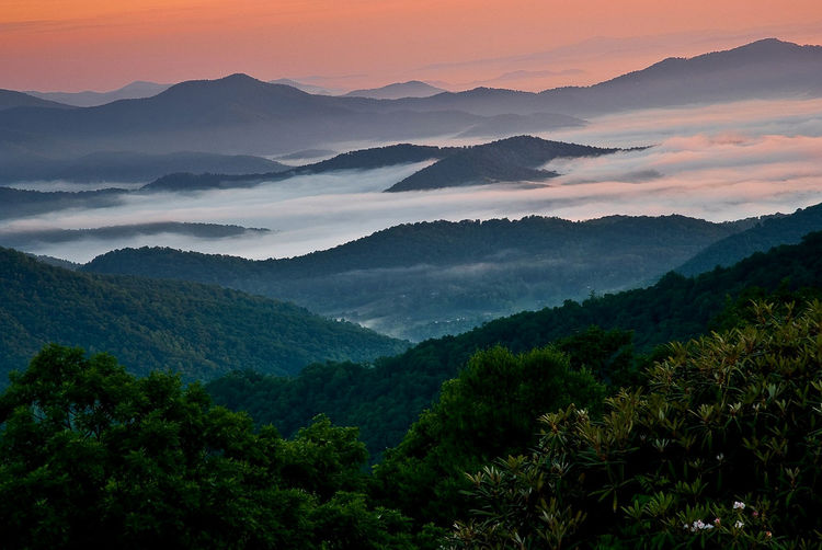 Scenic View Of Green Mountains During Sunset