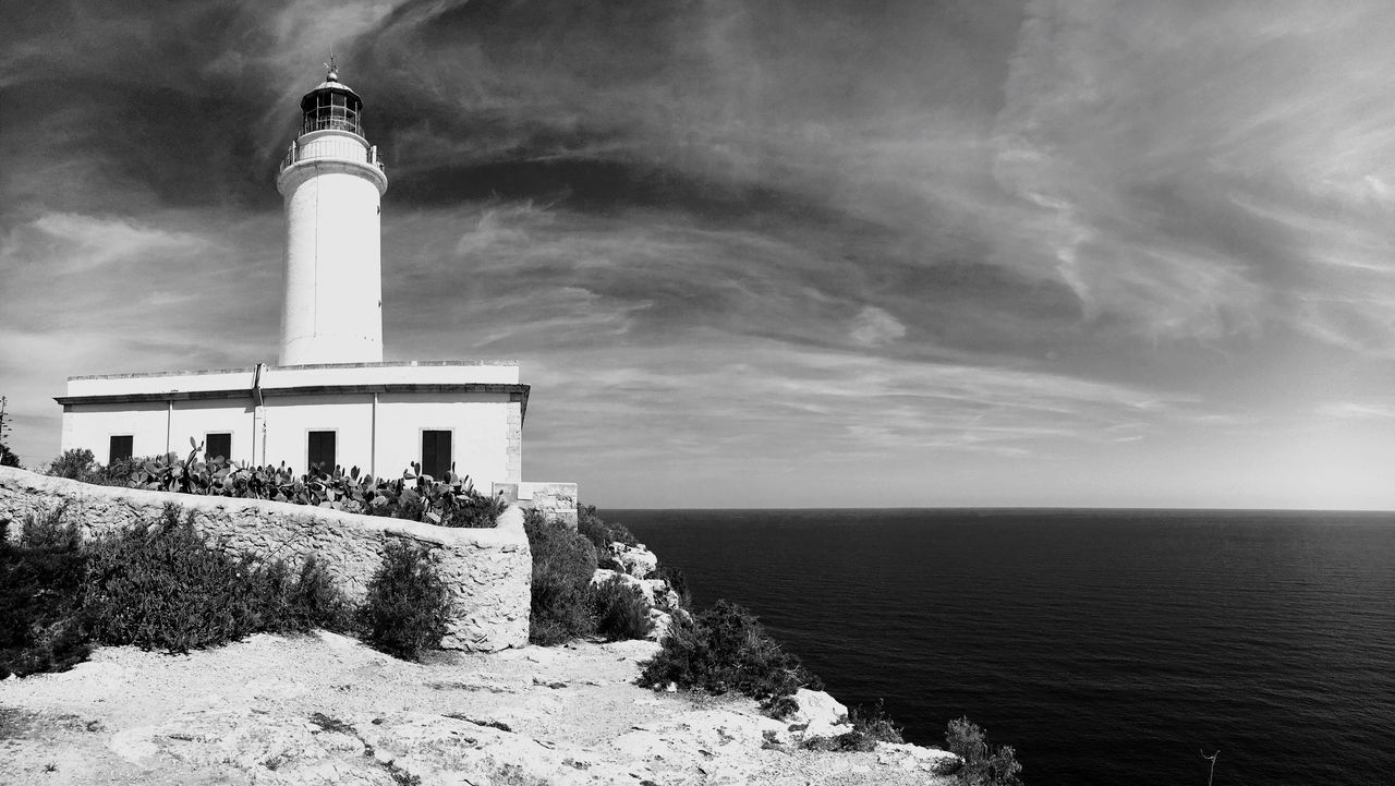 EyeEm Selects Formentera, September 2017. Built Structure Architecture Lighthouse Sea Nature Cloud - Sky Day Outdoors Peace Lifestyles EyeEmNewHere SPAIN Holiday Formentera Blackandwhite Rock - Object Direction Safety Scenics Tranquility Building Exterior Water Sky Protection