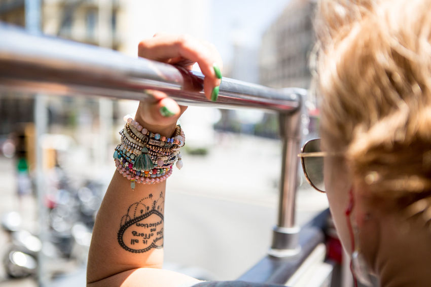 Adult Adults Only Beads Blond Hair City Close-up Day Drink Females Human Body Part Human Hand Only Women Outdoors People Sangria Street Art Tattoo Two People Women Young Adult Young Women Zebra