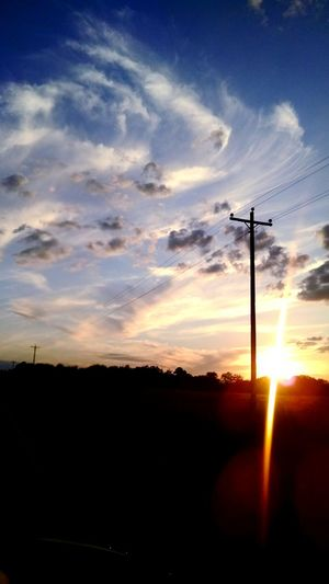 We were driving down in the middle of nowhere just leaving georgia and we were going 80 miles an hour and I grab my phone so tightly and roll down the window and take this gorgeous picture. Taking Photos Georiga Sunset Sunshine Farm Life Telegraph Pole My Favorite Photo